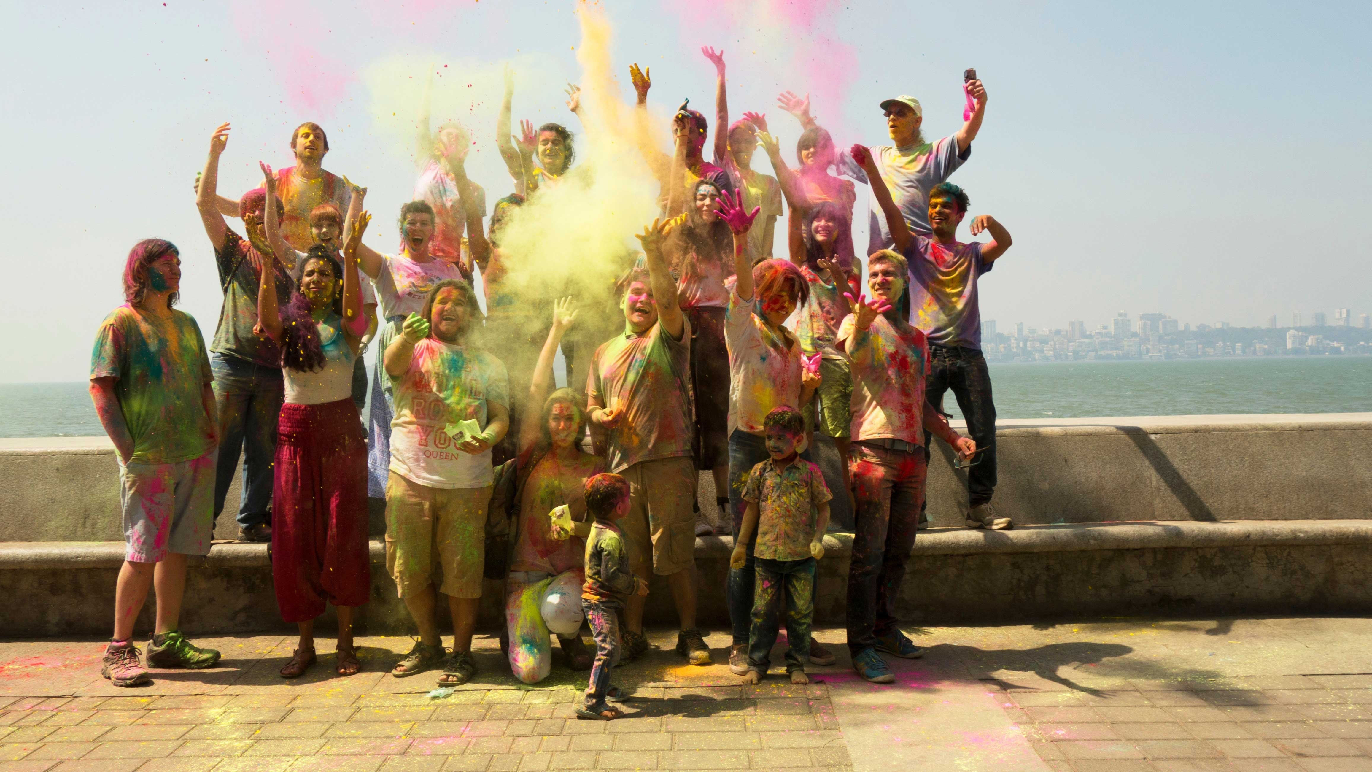 Students celebrating Holi, the festival of colors in Mumbai, India.