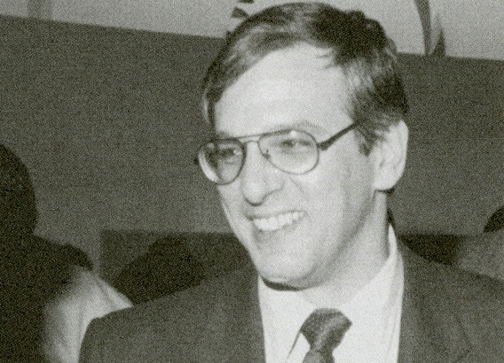 black and white photo of man with glasses