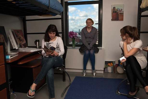three girls hanging out in dorm room