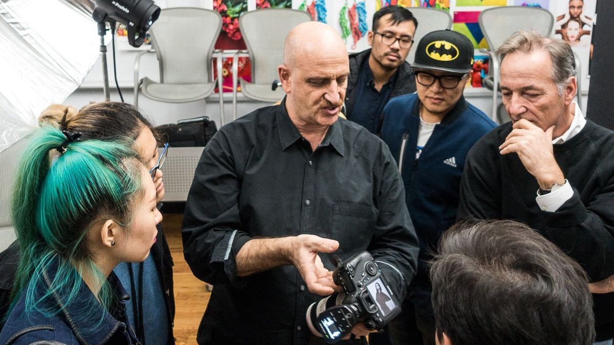 Professor demonstrating camera to students