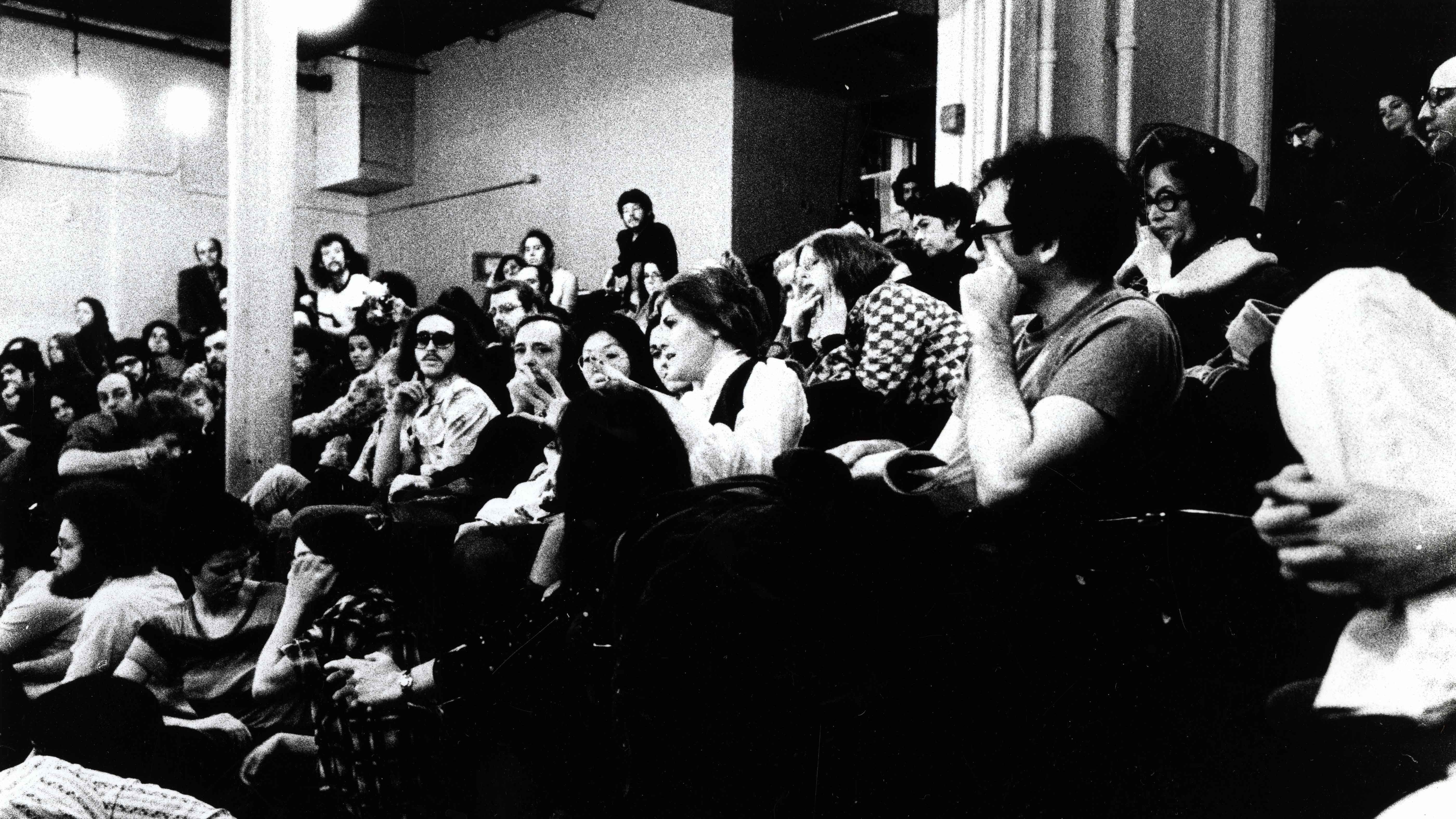 black and white photo of students in auditorium